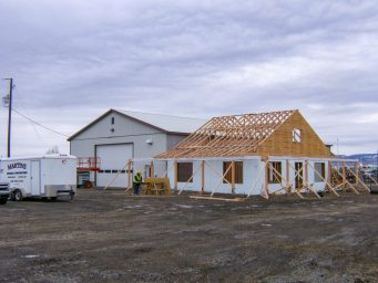 ceiling trusses being raised on shed company roof