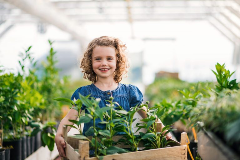 girl in small greenhouse