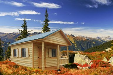 log cabin shed in mountains