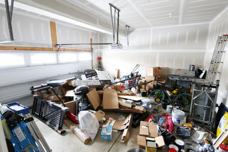 Unorganized messy garage before he purchased a shed in Island City and La Grande